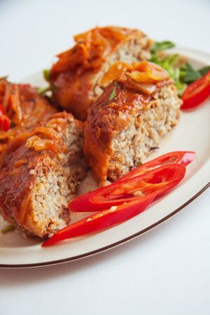 cutlets: fish cutlets with tomato sauce