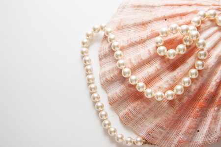 pearl shells with beads, teeth health Фото со стока