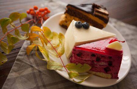 Three various dessert cakes on plate