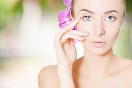 portrait of young woman with orchid spa