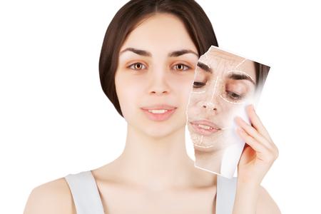 aging: brunette female model releases her skin from wrinkles Stock Photo