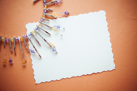 elegant background for design including postcard for text, drapery and metal necklace