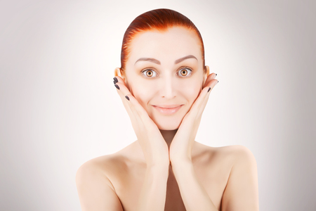 stunning red haired woman skin health concept Stock Photo