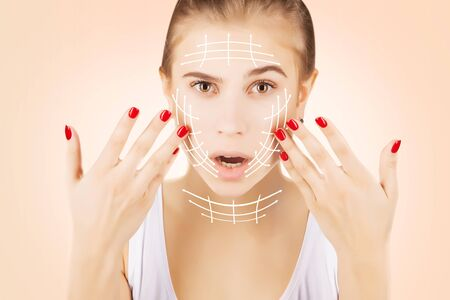 blond caucasian model portrait with surgery lines on face Stock Photo