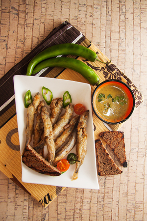 capelin fish fried in batter with sauce Stock Photo