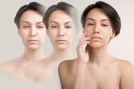 皮膚を持ち上げると若いアジアのモデルの古い皮膚の問題概念の肖像画