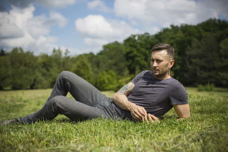 middle age man resting on grass