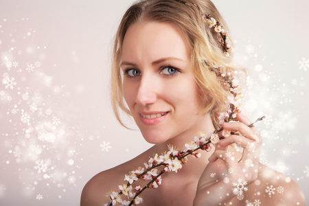 beautiful lady portrait with snowy christmas background