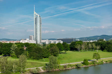 01 June 2019 Vienna, Austria - Distant view on The Millennium Tower on Danube river.