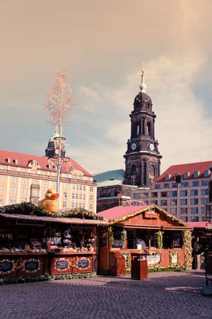 17 May 2019 Dresden, Germany - Fair stalls at Altmarkt. Kreuzkirche bellfry on background.