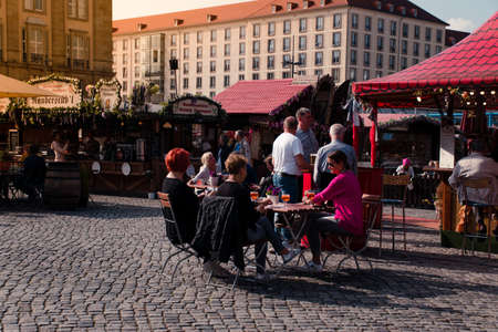 17 May 2019 Dresden, Germany - Biergarten at Altmarkt. People in a beer garden pub.