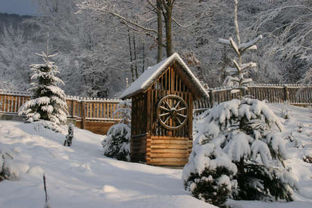 A draw-well in the Carphatian Mountains in Transylvania Stock Photo