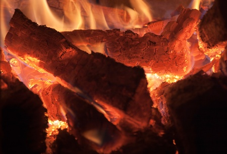 smithereens: Burning logs of firewood before falling into smithereens. Stock Photo