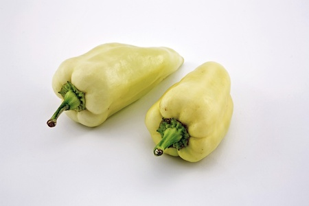 Two sweet hungarian peppers on white background