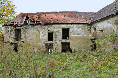 ruinous: Front view of an abandoned ruinous building