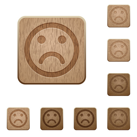 variations: Set of carved wooden sad emoticon buttons in 8 variations.