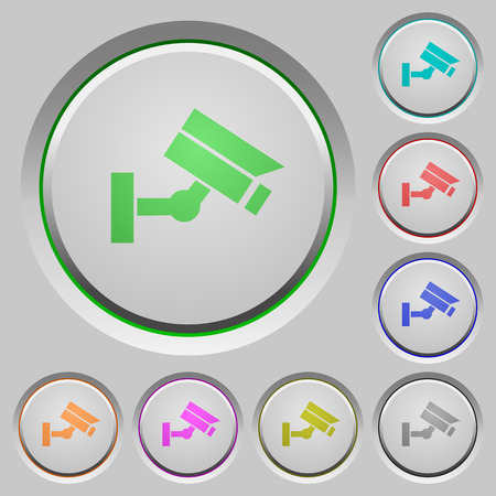 Security camera color icons on sunk push buttons