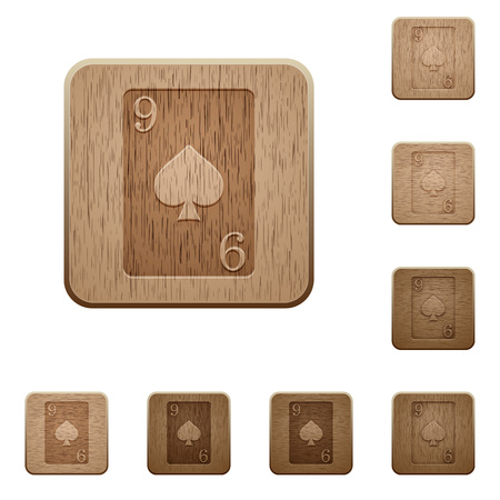 Nine of spades card on rounded square carved wooden button styles Foto de archivo - 111566384