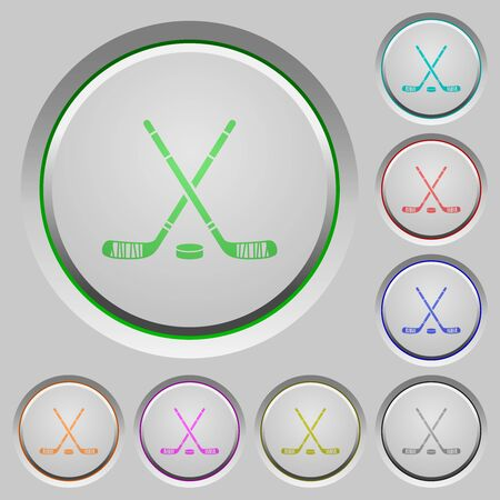 Hockey sticks with puck color icons on sunk push buttons