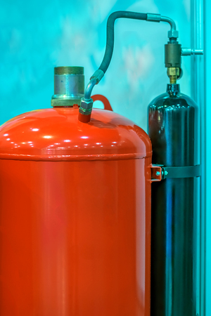Flammable gas cylinders with hoses and reducers Stock Photo