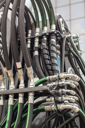 System of hydraulic and pneumatic hoses and tubes. Hydraulics and branch pipes Reklamní fotografie - 134432366