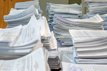 bundles bales of paper documents. stacks packs pile on the desk in the office