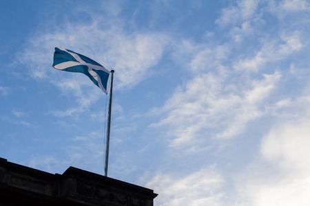 Blue Scottish banners waving in the sky Reklamní fotografie