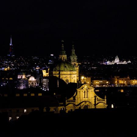 Night view on illuminated rainy Prague city