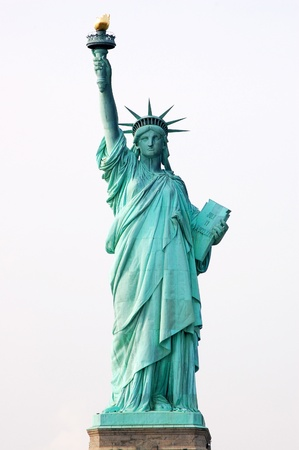 Front view of the Statue of Liberty in New York City on white background.