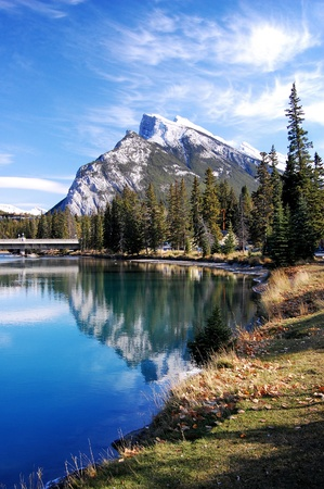 Perfect mountain scene with reflection and trees photographed in Banff, in the Canadian Rockies. Stock Photo - 9503751