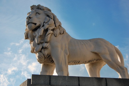 stone lion: White lion statue on Westminster Bridge in London. Stock Photo