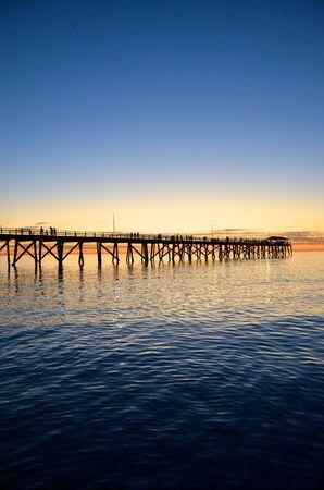 Jetty silhouette at sunset on Grange Beach, South Australia Stock Photo - 9592163