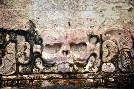 Ancient skull stone carving at the Palenque Ruins Stock Photo - 11071908