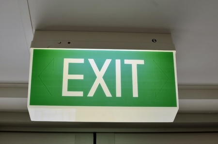 fire shows: A close up of an Australian green exit sign