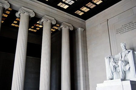 lincoln: Inside the Lincoln Memorial, showing great columns and the statue of Abraham Lincoln, in Washington DC.  Editorial