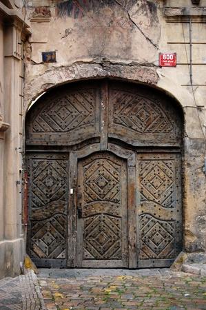 Old big steel doors on a building in Prague. photo