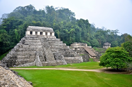 Palenque ruins in the morning mist photo