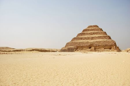 high desert: The ancient stepped pyramid at Saqqara in Egypt.  Stock Photo