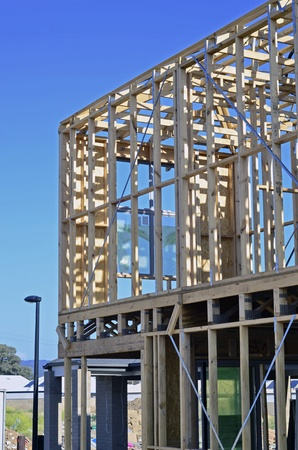 roof beam: Wooden frame of house under construction Stock Photo