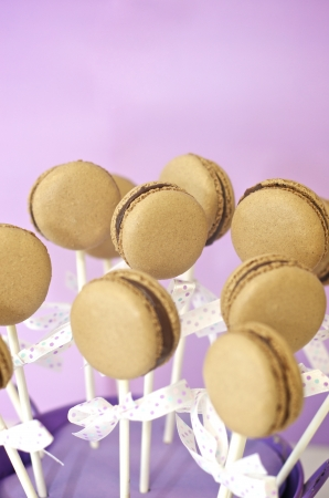 Chocolate macaron pops in a small bucket  photo