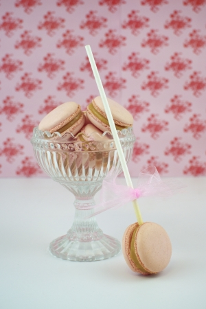 Strawberry   caramel chocolate macrons in a glass photo