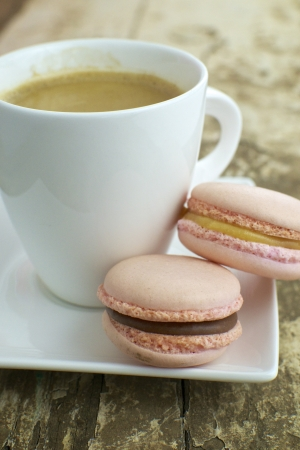 Strawberry   caramel with chocolate macrons with cup of coffee photo