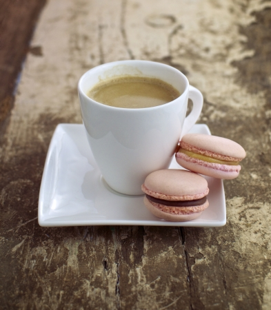 Strawberry   caramel macrons with cup of coffee  photo