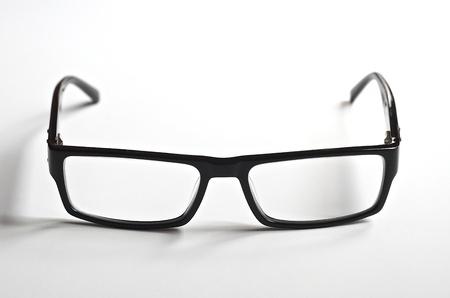 black rimmed: Black rimmed reading glasses on a white background