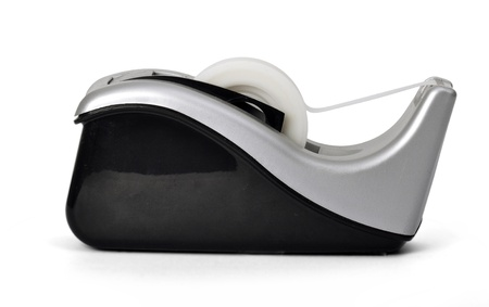 Side view of sticky tape dispenser on white background photo
