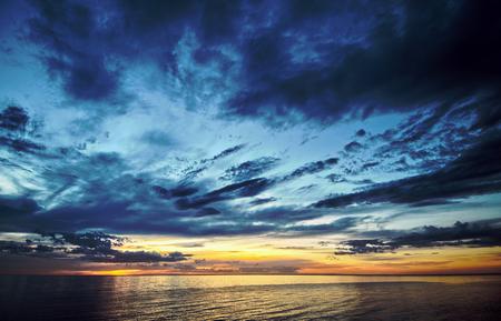 gold coast australia: A dynamic sky sunset over the ocean Stock Photo