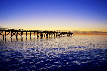 grange: Jetty silhouette at sunset on Grange Beach, South Australia Stock Photo