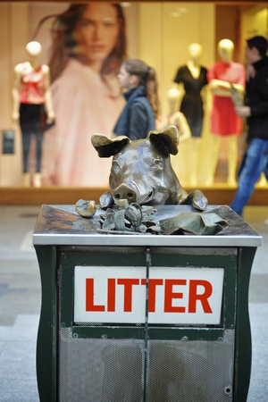 precinct: Adelaide, South Australia - February 24, 2015: A life-size bronze pigs statue in the shopping precinct of Rundle Mall.