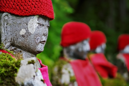 A row of Japanese Jizo statues in Ganman-ga-fuchi, Nikko, Japan Stock Photo - 18243808