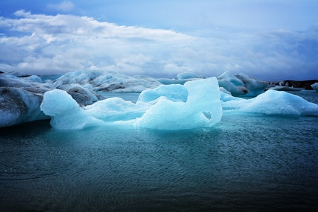 greenhouse effect: Melting icebergs at Jökulsárlón lagoon in Iceland with copyspace